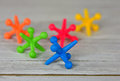 Close up of toy jacks on wood Royalty Free Stock Photo