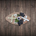 Close up of a tray of assorted rustic bread and cheese with olives and grapes. Royalty Free Stock Photo