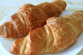 Close-up of Two Fresh Whole Wheat Croissant Pastries Served on White Plate Royalty Free Stock Photo