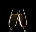 Close up of two glasses of Champagne clinking together isolated on black. Royalty Free Stock Photo