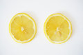 Close-up of two lemons slices in the white background