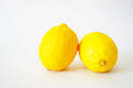 Close-up of two lemons in the white background
