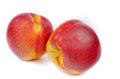 Close up of a two ripe nectarines juicy orange red on white background Stock Photos