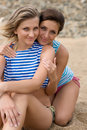 Close-up of two young women smiling on the beach Stock Image