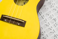 Close up ukulele a of a yellow and chord on clean table Stock Images