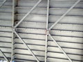 Close up of underside of the bay bridge with steel beams crossing for support Stock Photo