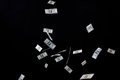 Close up of us dollar money flying over black Royalty Free Stock Photo