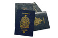 Close up of valid canadian passport passports the older and the new epassport with an electronic chip Royalty Free Stock Photos