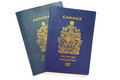 Close up of valid canadian passports the older and the new epassport with an electronic chip Stock Image