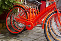 Close up vietnames red bicycle on the city street Royalty Free Stock Photo