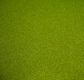 Close up view artificial green grass background Stock Image