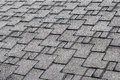 Close up view on Asphalt Roofing Shingles Background. Roof Shingles - Roofing. Roof shingles covered with frost Royalty Free Stock Photo
