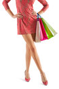Close up view on beautyful female legs and paper bags in her hand Stock Images