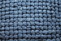 Close up view of blue knitted fabric background. Royalty Free Stock Photo