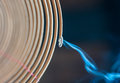 Close up view burning spiral incense stick blue smoke going down dark background traditional religious rituals temple religion Stock Photo
