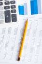 Close up view of business stationery pen diagrams calculator top Stock Photos