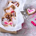 Collection of sweet heart shaped cookies on grey surface Royalty Free Stock Photo