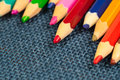 Close up view of crayons. Colored Pencils. Colored pencils on wooden background. Royalty Free Stock Photo