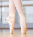 Close up view of dancing legs of ballerina in pointes wearing white the hall Stock Image