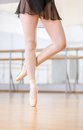 Close up view of dancing legs of ballerina in pointes wearing white the hall Stock Photo