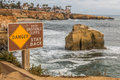 Close-Up View of Danger Sign at Sunset Cliffs Royalty Free Stock Photo