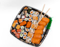 Close up view of fresh cooked sushi on white backg beautiful appetizing plate isolated background Royalty Free Stock Photography