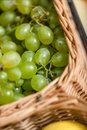 Close up view of grape in the braided basket concept healthy food Royalty Free Stock Photo