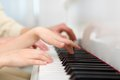 Close up view of hands playing piano concept music and arts Stock Photo
