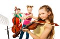 Close-up view of kids playing musical instruments Royalty Free Stock Photo