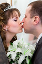 Close up view of kissing wedding couple Stock Photos