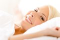 Close up view of lying in bed woman on white pillow Royalty Free Stock Images
