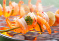 Close up view of mexican grilled shrimp on stick Royalty Free Stock Images