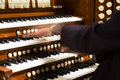 Close up view organist playing pipe organ motion blur Stock Photography