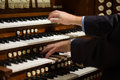 Close up view organist playing pipe organ motion blur Stock Images