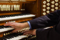 Close up view organist playing pipe organ motion blur Stock Image