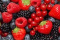 Close-up view on pile of different berries Royalty Free Stock Photo