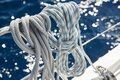 Close-up view of sailboat ropes at sunny weather, pulleys and ropes on the mast, Yachting sport, ship equipment, sea is Royalty Free Stock Photo