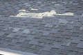 A close up view of shingles a roof damage. Roof Shingles - Roofing. Royalty Free Stock Photo