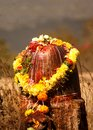 View of stone carved Indian Hindu god Shiva in the shape of Lingam used to offer prayers Royalty Free Stock Photo