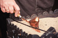 Close up view of turkish coffee prepared on hot  sand. Coffee preparation concept Royalty Free Stock Photo