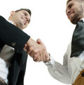 Close up view of two businessmen exchanging a hand shake of agreement isolate don white background Royalty Free Stock Photos