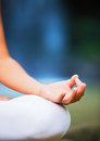 Close up view of woman in lotus position zen relaxation yoga Royalty Free Stock Images
