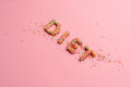 Close-up view of word diet made from sweets isolated on pink