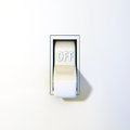 Close up of a wall light switch in the off position Stock Photography