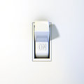 Close up of a wall light switch in the on position Stock Photography