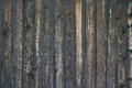 Close up of wall made of wooden planks painted in dark brown stain cracked in the sun Royalty Free Stock Photography