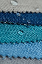 Close up water drop on gunny textile samples. Concept for easy clean, waterproof surfaces Royalty Free Stock Photo