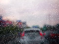 Close up a water drop of rain on a winshield with blurred traffic jam on a street,selective focus,abstract texture,vintage texture Royalty Free Stock Photo