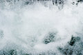 Close up of water falling and bubbling waterfall clean cold river Royalty Free Stock Photos
