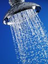 Close up of water flowing out of chrome shower head Stock Photo
